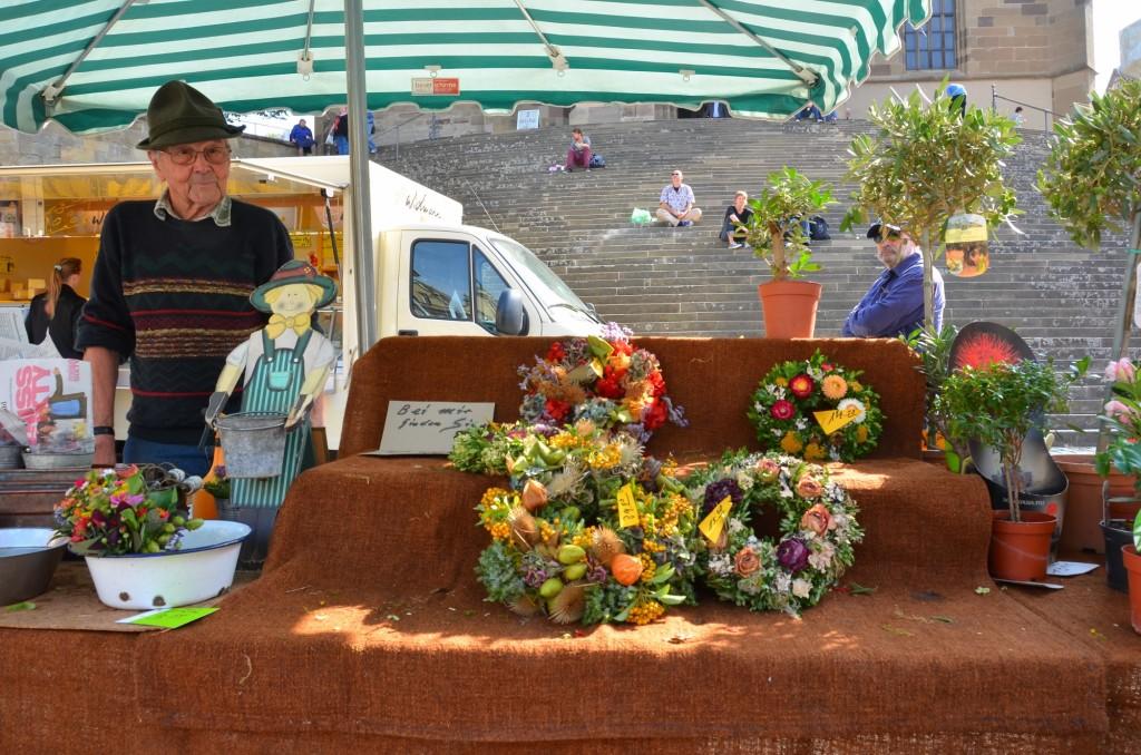 vendedor feira flor guirlanda
